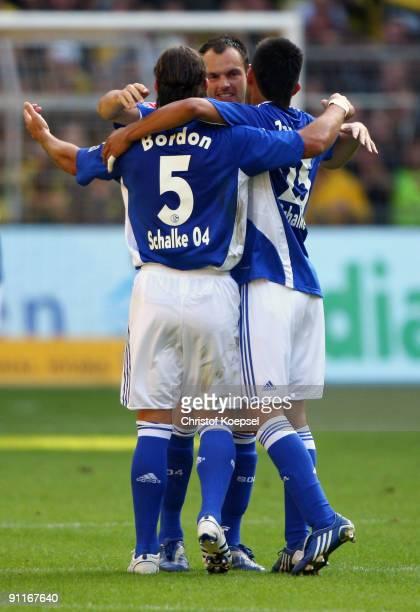 Heiko Westermann of Schalke celebrates scoring his team's first goal with team mates Marcelo Bordon and Carlos Zambrano during the Bundesliga match...