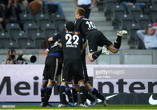 Heiko Westermann of Schalke celebrates with his team mates after scoring his team's first goal during the Bundesliga match between Hertha BSC Berlin...