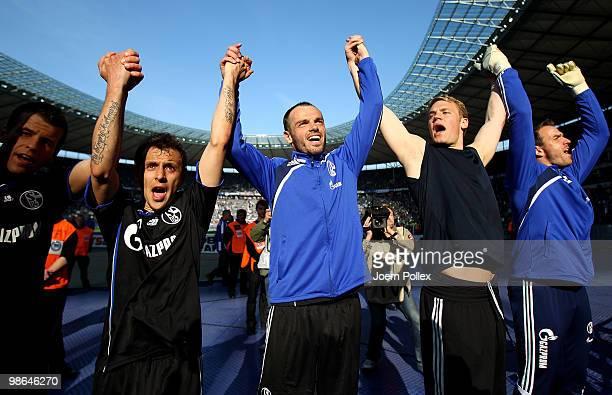 Heiko Westermann of Schalke celebrates with his team mates after winning the Bundesliga match between Hertha BSC Berlin and FC Schalke 04 at the...