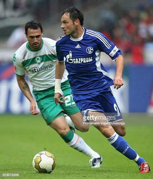 Heiko Westermann of Schalke challenges Hugo Almeida of Bremen for the ball during the Bundesliga match between Werder Bremen and FC Schalke 04 at the...