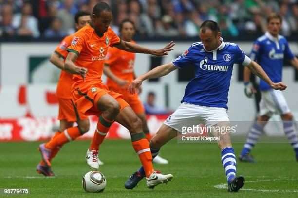 Heiko Westermann of Schalke challenges Naldo of Bremen during the Bundesliga match between FC Schalke 04 and SV Werder Bremen at Veltins Arena on May...