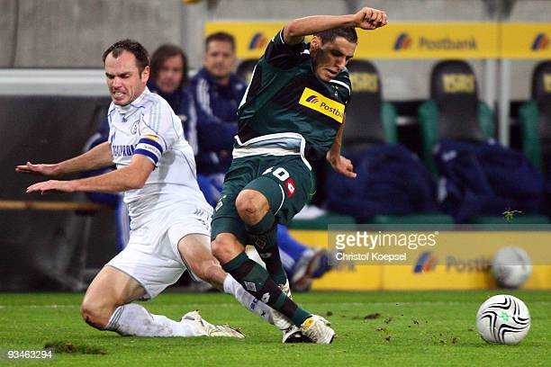 Heiko Westermann of Schalke tackles Karim Matmour of Moenchengladbach during the Bundesliga match between Borussia Moenchengladbach and FC Schalke 04...