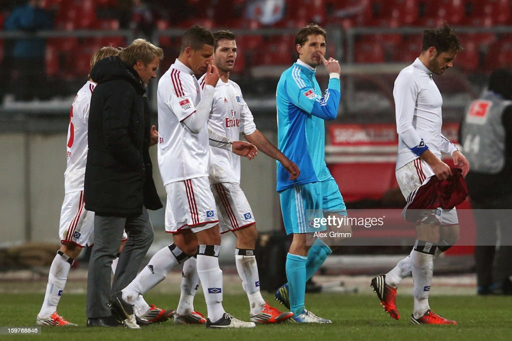 Heiko Westermann, Rene Adler, Dennis Diekmeier, Jeffrey Bruma, head coach Thorsten Fink and Per Skjelbred (R-L) of Hamburg react after the Bundesliga match between 1. FC Nuernberg and Hamburger SV at Easy Credit Stadium on January 20, 2013 in Nuremberg, Germany.