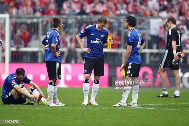 Heiko Westermann Robert Tesche Marcell Jansen Gojko Kacar and goalkeeper Frank Rost of Hamburg react after the Bundesliga match between FC Bayern...