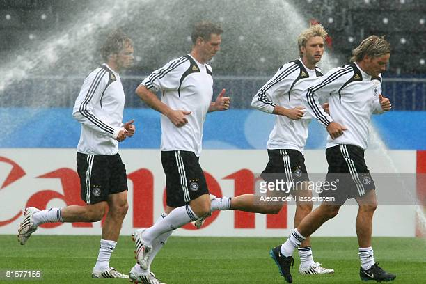 Heiko Westermann, Tim Borowski, Simon Rolfes and Clemens Fritz of Germany warm up during Germany training at Ernst Happel Stadion on June 15, 2008 in...