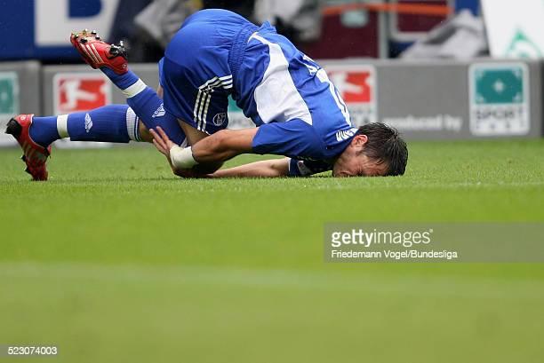 Heiko Wetermann of Schalke is injured during the Bundesliga match between Werder Bremen and FC Schalke 04 at the Weser stadium on August 23 2008 in...