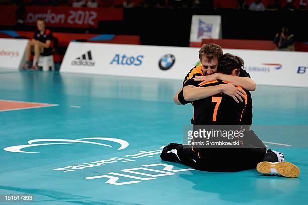 Heiko Wiesenthal of Germany and teammate Torben Schiewe celebrate after winning the bronze in the Men's Sitting Volleyball competition on day 10 of...