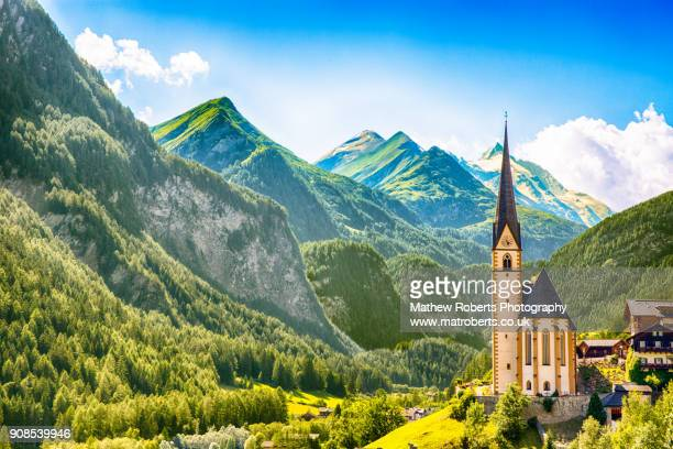 heiligenblut church grossglockner hockalpenstrasse - austria stock pictures, royalty-free photos & images