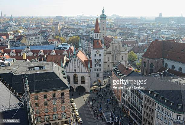 heiliggeistkirche church amidst houses in town - heidelberg stock photos and pictures