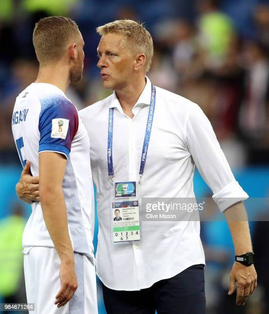 Heimir Hallgrimsson Manager of Iceland speaks with Sverrir Ingason of Iceland following their sides defeat in the 2018 FIFA World Cup Russia group D...