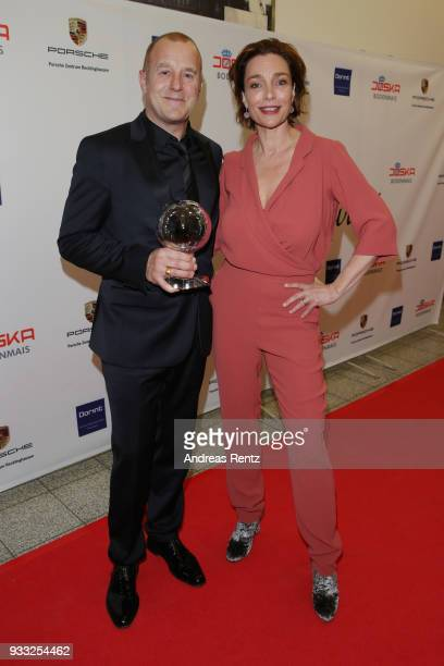 Hein Ferch with his award and laudator Aglaia Szyszkowitz attend the Steiger Award at Zeche Hansemann on March 17 2018 in Dortmund Germany