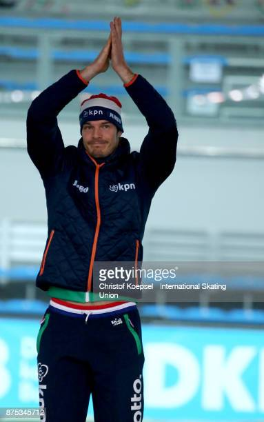 Hein Otterspeer of the Netherlands poses during the medal ceremony after winning the 2nd place after the first men 500m Division A race during Day 1...