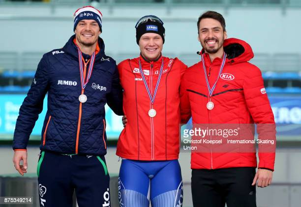 Hein Otterspeer of the Netherlands poses during the medal ceremony after winning the 2nd place Havard Holmjefjord Lorentzen of Norway poses during...
