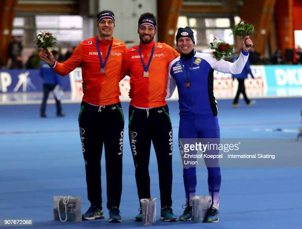 Hein Otterspeer of the Netherlands poses during the medal ceremony after winning the 2nd place Kjeld Nuis of the Netherlands poses during the medal...