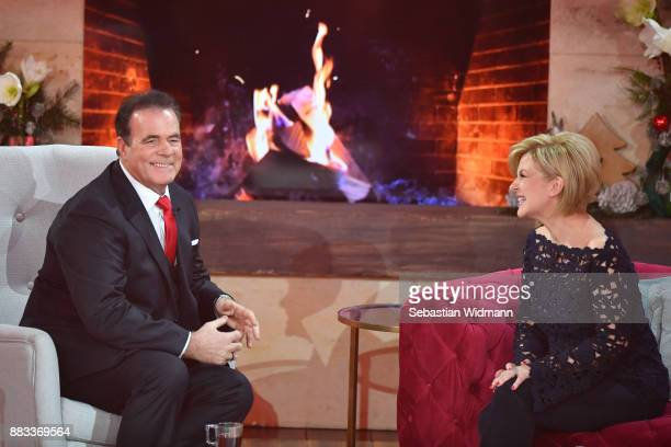Hein Simons and Carmen Nebel talk during the tv show 'Heiligabend mit Carmen Nebel' on November 29 2017 in Munich Germany The show will be aired on...