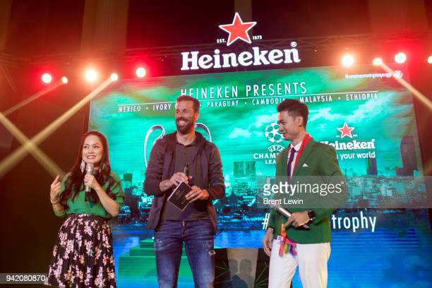 Heineken Ambassador Ruud Van Nistelrooy center stands on stage during the UEFA Champions League Trophy Tour presented by Heineken on April 4 2018 in...