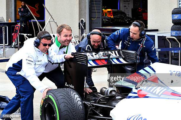 Heineken ambassador Scott Quinnell helps the Williams team during a pit stop practice during previews to the Canadian Formula One Grand Prix at...