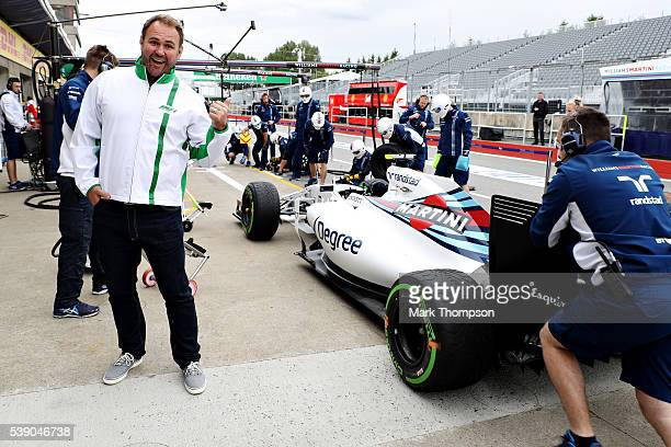 Heineken ambassador Scott Quinnell next to the Williams team during a pit stop practice during previews to the Canadian Formula One Grand Prix at...
