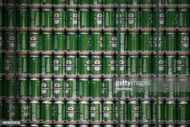 Heineken beer cans sit stacked at the Heineken NV brewery in Zoeterwoude Netherlands on Wednesday May 30 2018 Heineken has acquired Stellenbrau a...