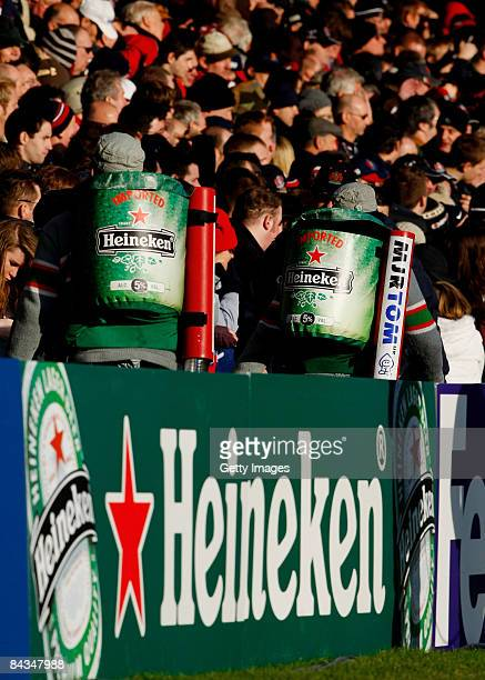 Heineken beer sellers sell their beer before the Heineken Cup round 5 match between Gloucester and Cardiff Blues at Kingsholm on January 18 2009 in...