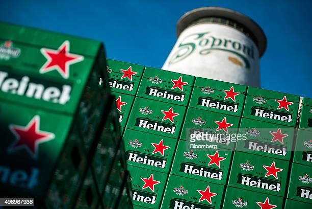Heineken branded crates stand stacked outside the Heineken Hungaria Breweries Plc Sopron brewery in Sopron Hungary on Thursday Nov 12 2015 Heineken...
