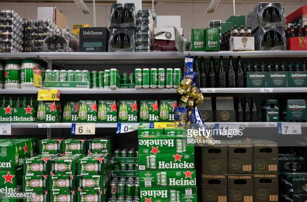 Heineken cans are seen displayed for sale at a Carrefour supermarket in Spain