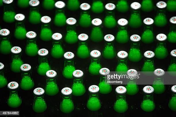 A Heineken logo sits on the bottle caps of Heinken beer as it travels along the production line at the Heineken NV brewery in Saint Petersburg Russia...
