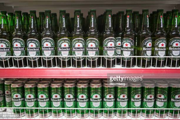 Heineken NV bottles and cans of lager are displayed at a Nomin Holding supermarket in Ulaanbaatar Mongolia on Saturday Aug 12 2017 The Mongolian...