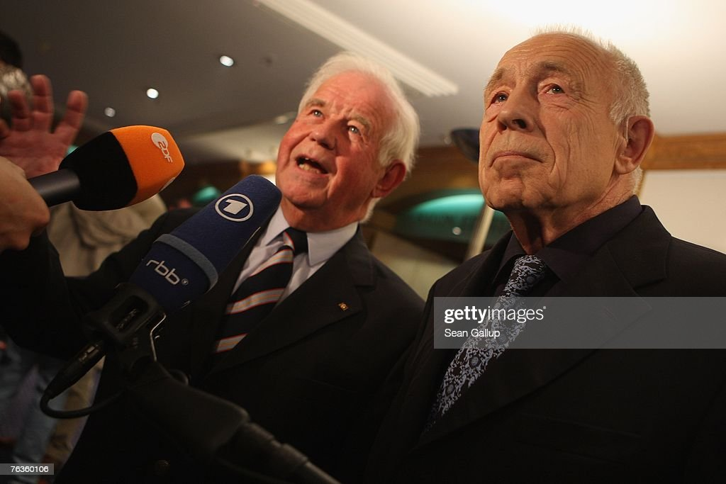 Heiner Geissler (R) and Kurt Biedenkopf, mediators in the current negotiations between German rail carrier Deutsche Bahn and the German union of locomotive drivers, the GDL, depart after giving a joint press conference at the Park Inn hotel August 28, 2007 in Berlin, Germany. The two mediators announced they had found enough common ground to reach an agreement in the dispute, whcih is centered on wages.