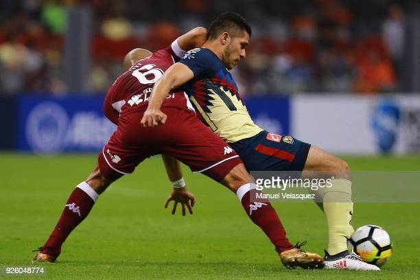Heiner Mora of Saprissa struggles for the ball against Henry Martin of America during the match between America and Saprissa as part of the round of...