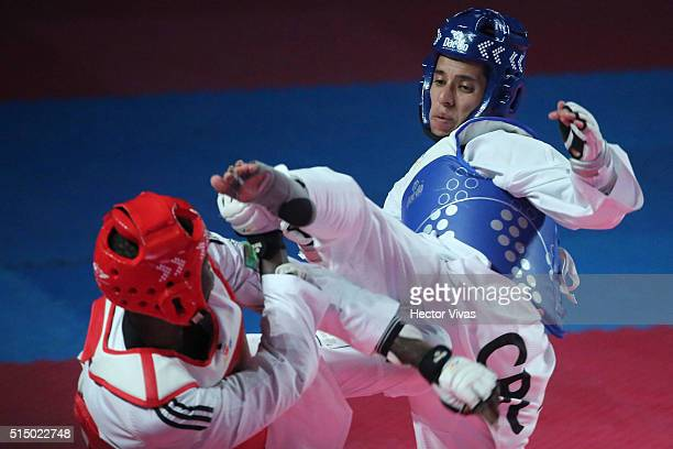 Heiner Oviedo of Costa Rica competes with Luis Pie of Dominican Republic during the men's 58 kg category semifinal fight as part of the Taekwondo...