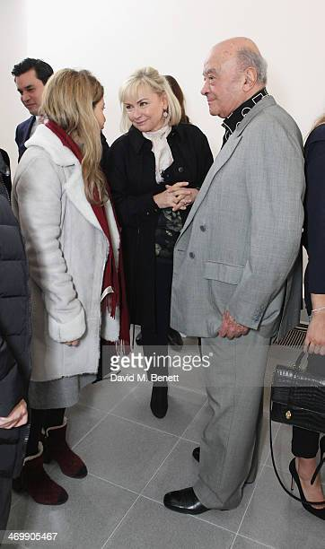 Heini AlFayed and Mohamed AlFayed are seen front row for ISSA Autumn/Winter 2014 Show at The Serpentine Sackler Gallery on February 17 2014 in London...