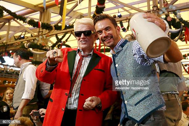 Heino and Florian Silbereisen attend the opening of the 2016 Oktoberfest beer festival at Theresienwiese on September 17 2016 in Munich Germany The...