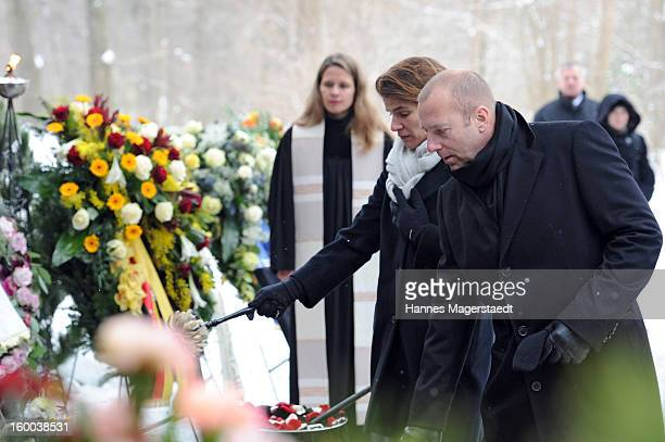 Heino Ferch and his wife MarieJeanette attend the memorial service for Steffen Kuchenreuther at the Waldfriedhof on January 25 2013 in Munich Germany