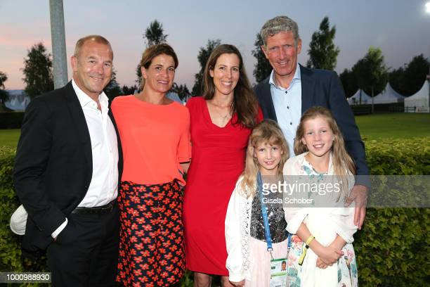 Heino Ferch and his wife MarieJeanette Ferch Ludger Beerbaum and his wife Arundell Davison and their daughters during the media night of the CHIO...