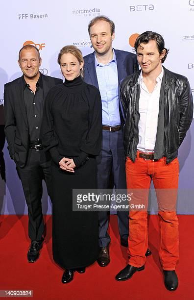 Heino Ferch, Bernadette Heerwagen, Stephan Grossmann and Felix Klare attend the premiere of 'Muenchen 72- Das Attentat' at Astor Film Lounge on March...