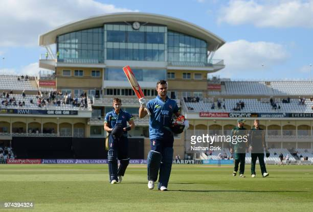 Heino Kuhn of Kent raises his bat after scoring 124 not out during the Royal London OneDay Cup match between Nottinghamshire Outlaws and Kent...