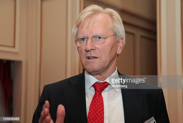 Heinrich Haasis president of the Deutscher Sparkassen und Giroverband speaks to a reporter between sessions at the the Banks in Crisis conference in...