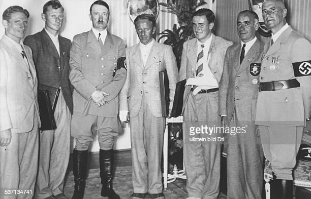 Heinrich HarrerHeinrich HarrerWilhelm FrickWilhelm FrickAdolf Hitler Ludwig Vörg Politiker NSDAP D Empfang für die Bergsteiger die am als erste die...