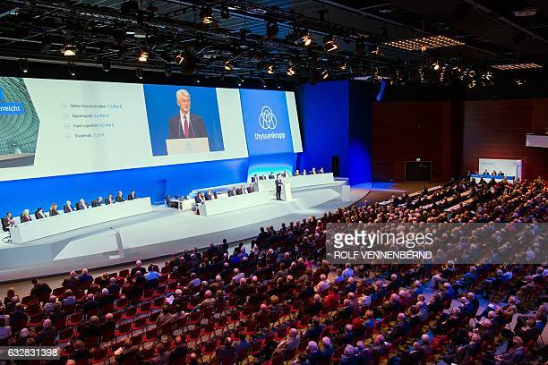 Heinrich Hiesinger chairman of German industrial group ThyssenKrupp is displayed on a giant screen as he speaks to shareholders during his company's...