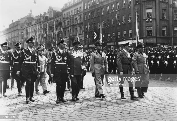 Heinrich Himmler Field Marshal Hermann Goering Italian Foreign Minister Count Ciano German Chancellor Adolf Hitler and Italian leader Benito...