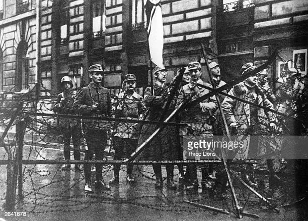 Heinrich Himmler holding a flag with a group of Nazi storm troopers during the Beer Hall Putsch in Munich