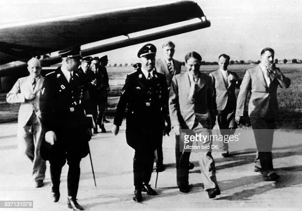 Heinrich Himmler Politician Nazi Party Germany Himmler receiving members of an SSTibetExpedition on their return at Munich Riem Airport right next to...