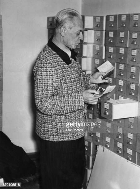 Heinrich Hoffmann official photographer to Adolf Hitler at work on his files after the war circa 1946 He destroyed them and is having to recreate his...