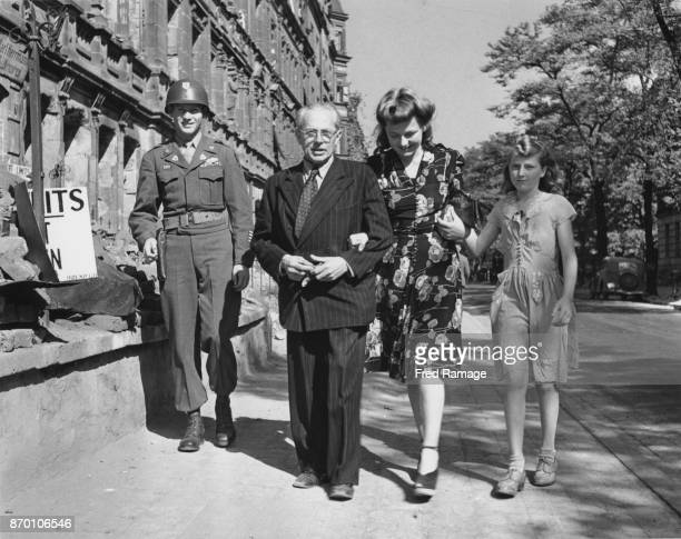 Heinrich Hoffmann official photographer to Adolf Hitler out walking in Nuremberg with his wife and stepdaughter and an armed guard 28th September...