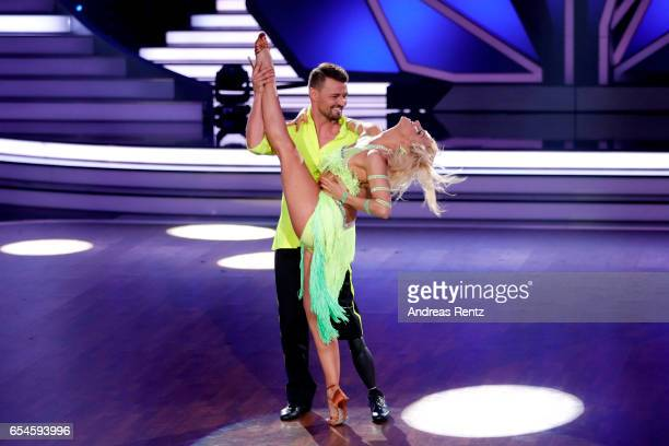 Heinrich Popow and Kathrin Menzinger perform on stage during the 1st show of the tenth season of the television competition 'Let's Dance' on March 17...
