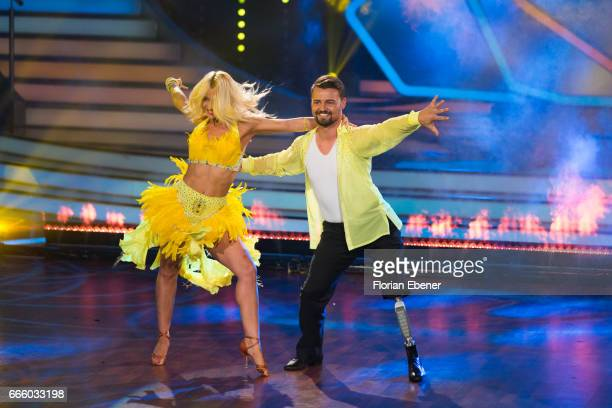 Heinrich Popow and Kathrin Menzinger perform on stage during the 4th show of the tenth season of the television competition 'Let's Dance' on April 7...