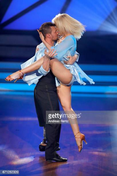 Heinrich Popow and Kathrin Menzinger perform on stage during the 5th show of the tenth season of the television competition 'Let's Dance' on April 21...