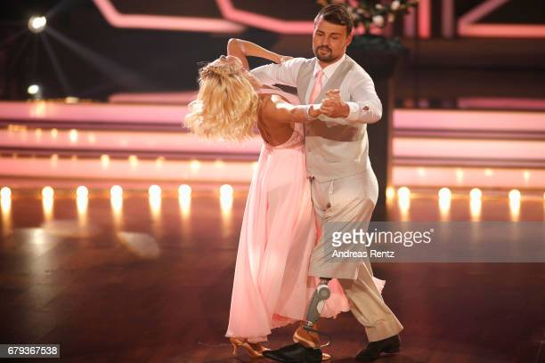 Heinrich Popow and Kathrin Menzinger perform on stage during the 7th show of the tenth season of the television competition 'Let's Dance' on May 5...