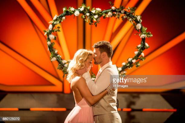 Heinrich Popow and Kathrin Menzinger perform on stage during the 7th show of the tenth season of the television competition 'Let's Dance' on May 5,...